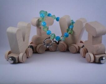 Handmade Blue and Lime bracelet with Claddagh charm