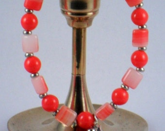 Handcrafted stretchy bracelet coral beads and moon charm