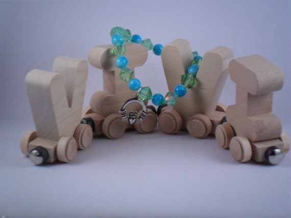 Handmade Blue and Lime bracelet with Claddagh charm