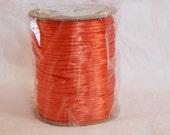 Spool of Orange Satin Cord
