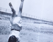 vintage photograph - handstand in the sand