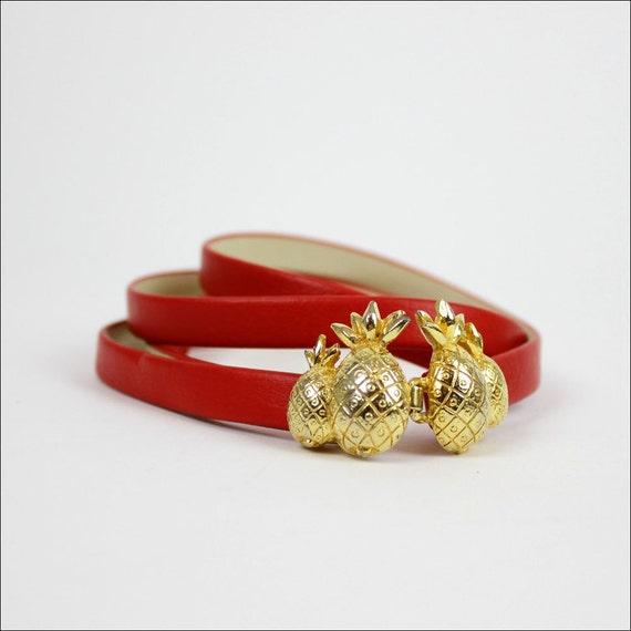 red skinny belt / gold pineapple buckle
