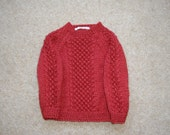 Rust Jumper  hand knitted in blackberry stitch for a toddler