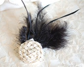 Ivory rosette with black feathers hair clip