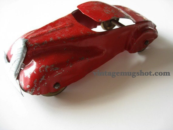Sale  64 dollars Vintage 30's Pressed Steel Red Coupe six inches Wyandotte steel wheels