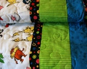 Crib Quilt Robert Kaufman's Celebrate Seuss for baby with red minky dot backing