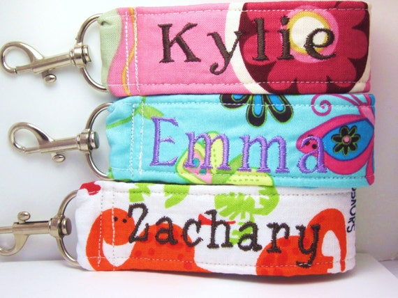 4 kids name tags includes child's name on one side & phone number on other.  Great for luggage, backpacks, toys, etc