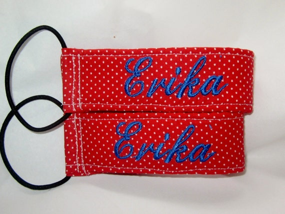 2 kids name tags (1 set).  The design includes child's name on one side & phone number on other.  Great for luggage, backpacks, toys, etc
