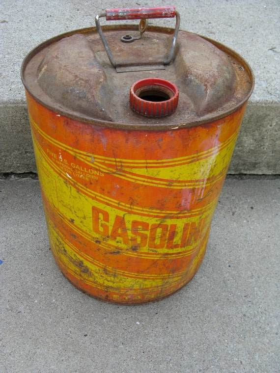 metal gasoline can red and yellow 5 gallons rusty rustic photo prop great graphics