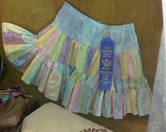 Toddler's size 4 twirl skirt made from bali pops taffy quilt fabric.