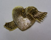 Heart with a flare brooch by the American Jewelry Company