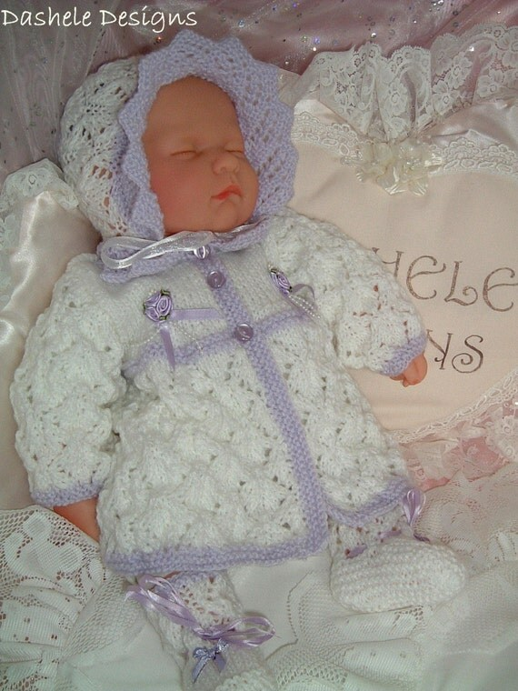 Pretty knitting pattern to fit 16 inch - 20 dolls or prem baby