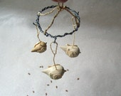 Small flight wooden birds with hanging , wood carving