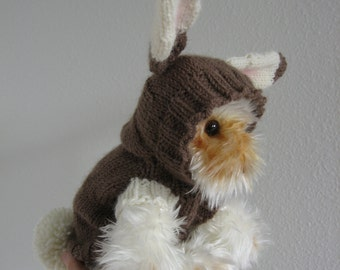 A brown and white bunny sweater for your pet with a pompon tail.