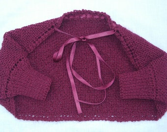 Shrug, bolero, sweater, cardigan, shoulderette,sweater, hand knitted from a vintage pattern. Baby girl, age 3-9 months. Ruby red wool.