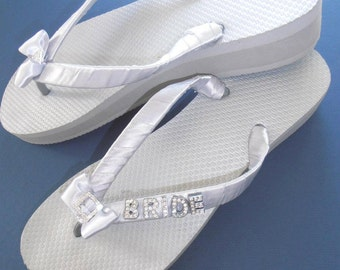 BRIDE wedge flip flops