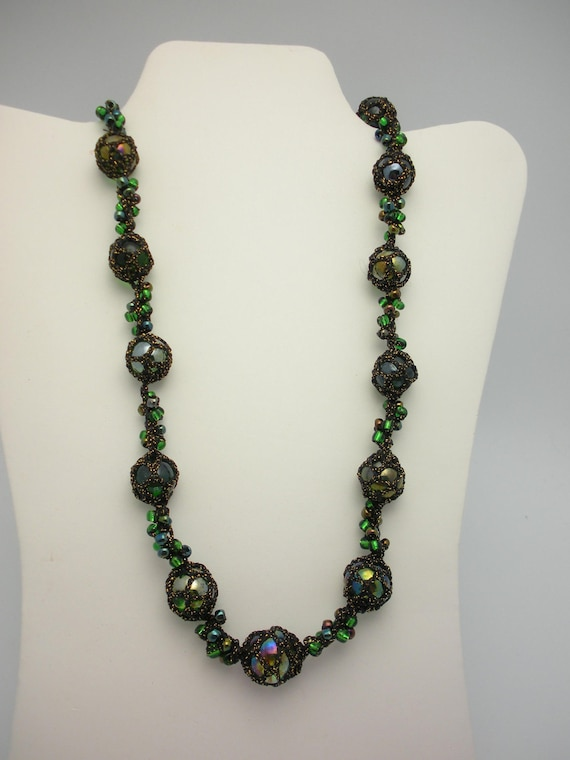 Green glass bead necklace crocheted with sparkling thread.