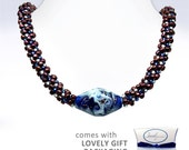 Beaded Necklace with Handcrafted Focal Bead and accents of Blue, gold, copper, white and raspberry
