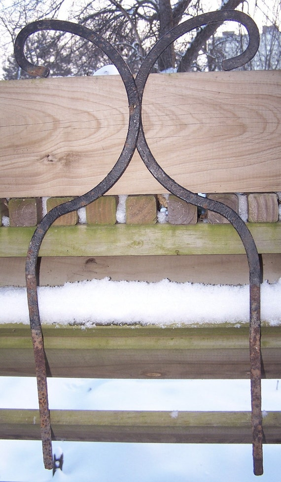 Old rustic wrought iron garden stake border fence by habitats