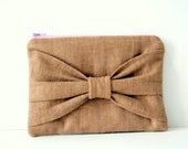 bow pouch in brown linen with lilac zipper