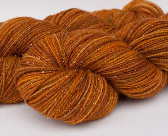 Handpainted Silk and Silver fingering yarn in rich peach/orange tones