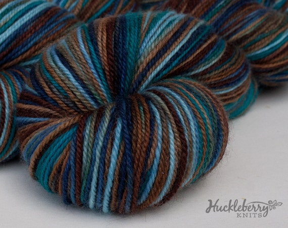 Blue, brown, and turquoise handpainted sock yarn: SLEEPING BEAR on Blue-Faced Leicester/nylon fingering, 4 oz