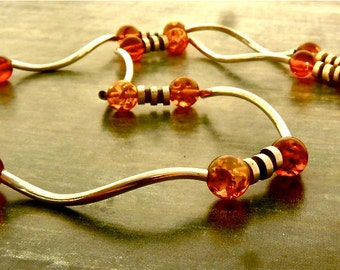 Quiet elegance: amber and silver necklace