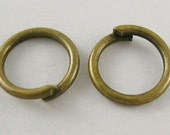 Jump Rings 6mm antique Brass .6mm thick 100pcs.