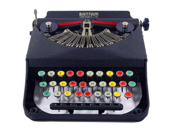 RARE Antique Bantam Manual Typewriter with Colored Glass Keys made by Remington in the Original Case