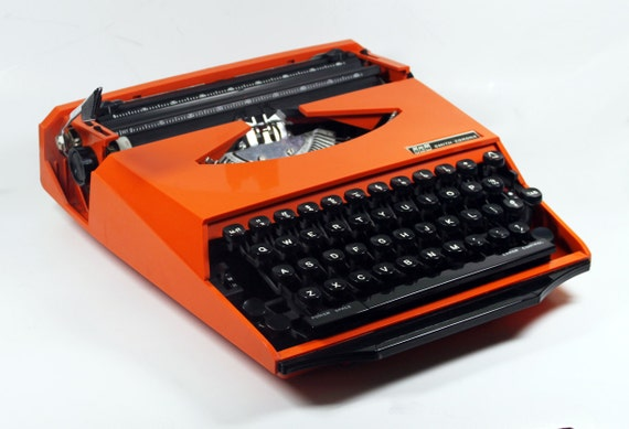 "Orange Smith Corona Karmann Ghia ""Super G""  Manual Typewriter"