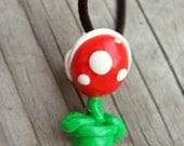 Piranah plant necklace on black leather cord
