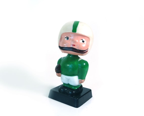 Vintage bobble head doll -high school football green white