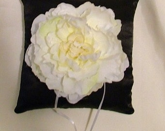 white flower on you choice color pillow