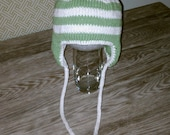 Knit earflap beanie, child to small adult size.