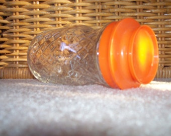 Anchor Hocking glass canister jar with a retro diamond pattern design and orange lid