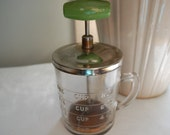 Vintage glass nut chopper with wooden disk