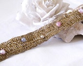 Mintook- knitted Bracelet in crochet work, with thin golden metal wire and pearls.