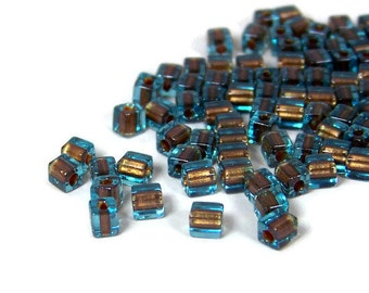 4mm glass beads, square blue with brown color lined hole, Miyuki cubes 200 beads (432SB)