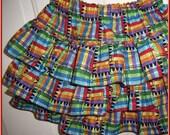 SKIRT  Crayon design in a three tiered twirl ruffled skirt.