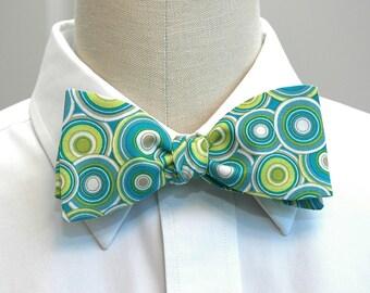 Men's bow tie in retro green, blue and aqua circles (self-tie)