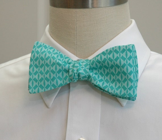 Men's bow tie in turquoise and aqua geometric pattern