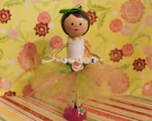 handmade clothespin doll for a cake topper tutu