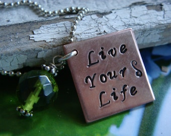 Live Your Life necklace copper square with peridot green crystal