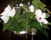 Magnolia And Leaves Floral Arrangement-Natural White Magnolias, Grape Leaves, Pearl Strands,  Moss Set In A Curvy Glass Vase