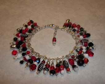 Beautiful Red, White, Black, And Silver Loaded Charm Bracelet