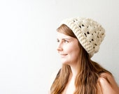Crocheted feminine hat in sparkly white - perfect for spring.