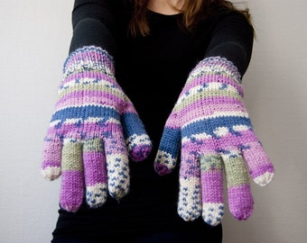 Hand knit wool blend gloves in blue denim, green, purple and pink stripes.