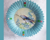 Wall Clock Light Blue Flower shape with a bird scene was 25.00 now 18.00.  SEE DESCRIPTION.