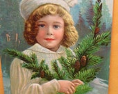 Christmas Postcard Girl in White Coat & Hat on Winter Day with Pine Branch