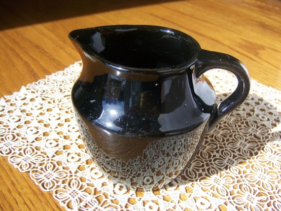 Vintage pitcher is small, perfect for serving syrup, cream or sauce. Black ceramic pottery. Vintage wedding shower gift basket idea.